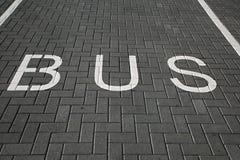 Bus Lane Sign. Bus lane dark asphalt texture Stock Photography