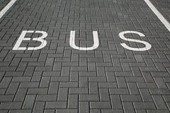 Bus Lane Sign. Bus lane dark asphalt texture Stock Images