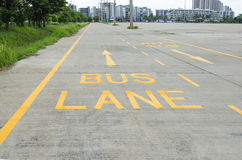 Bus lane sign painted on concret road Stock Image