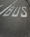 Bus lane sign road marking Royalty Free Stock Photography