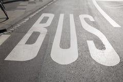 Bus Lane Sign. On Street Surface Stock Photo