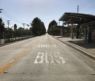 Bus Only Lane in Valley Village Neighborhood of Los Angeles. Los Angeles, CA / USA - April 28, 2018: A BUS ONLY lane is shown next to a bus stop in the Valley stock photo