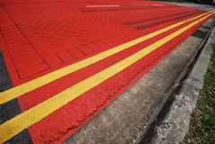 Bus Lane. A wide angle photo taken on a red pained bus lane on a road Royalty Free Stock Images