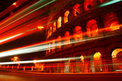 Bus light trails passing Colosseum Royalty Free Stock Image