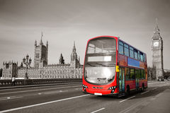 Bus in London. Double-deck red bus on Westminster Bridge with Big Ben in London Royalty Free Stock Photos