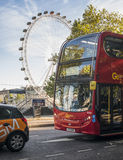 Bus on London street and The London Eye Stock Image