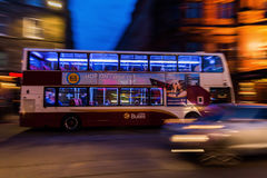 Bus from Lothian Buses at night in motion blur. Edinburgh, Scotland - September 12, 2016: bus from Lothian Buses at night. Lothian Buses is the largest municipal Royalty Free Stock Photography