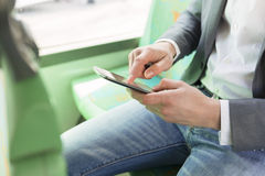 On bus man using his cell phone. Reading emails. texting  messag Stock Photography
