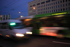 Bus and minibus motion blurred. The bus and minibus traffic at dusk along the street with motion blur royalty free stock images