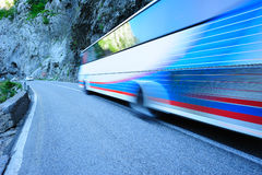 Bus in motion. Bus moving along the mountain road Stock Image
