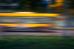 Bus in motion blur on street at night