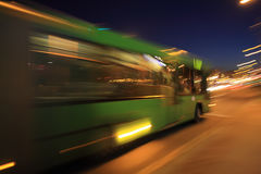 Bus with motion blur. Traffic bus on the street late at night with motion blur stock photos