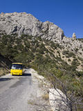 Bus on mountain road Sudak - Novy Svet in Crimea. Royalty Free Stock Images