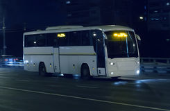 Bus moves at night. Bus moves on city street at night Stock Photo