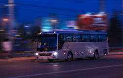 Bus moves at night. Bus moves on city street at night Stock Images