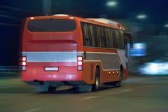 Bus moves at night Stock Photos