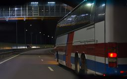 Bus Moves Over Night Highway. Bus Moves Over Night Illuminated Highway Royalty Free Stock Photo