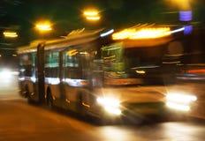 Bus is moving around the night city Stock Photos