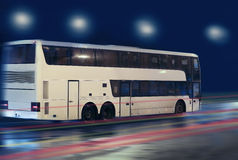 Bus moving on the night city. Street Stock Images