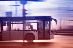 Bus moving on the road in city in early morning Royalty Free Stock Images