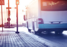 Bus moving on the road in city in early morning Royalty Free Stock Photos