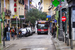 Bus in a narrow street in Madrid Royalty Free Stock Image