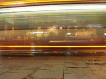 Bus at night. Night shot of a bus station, long time exposure, motion blured bus lights Royalty Free Stock Images