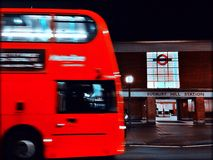 Bus at night. Bus passing tube station at night, London, UK Stock Images