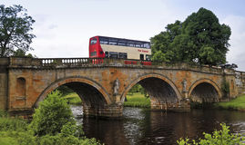 A Bus on an Old Bridge in England Royalty Free Stock Photography