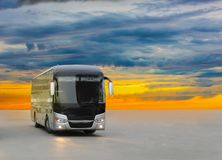 Free Bus On Asphalt In The Evening On Sunset Royalty Free Stock Images - 127236149