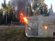 Bus op brand Stock Afbeeldingen