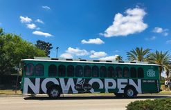 Trolley Bus completely Wrapped in Adverstising. A bus in Orlando, Florida is completely wrapped advertising for Bar Louie Stock Images