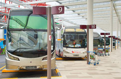 Bus parking at airport. Singapore. SINGAPORE - JANUARY 13, 2017: Bus parking at Changi International Airport. Changi Airport serves more than 100 airlines Stock Image