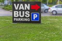 Bus parking sign next to the road Stock Photo