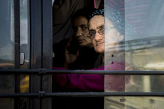 Bus passenger glanced outside window of moving vehicle at Himachal Pradesh. Stock Images