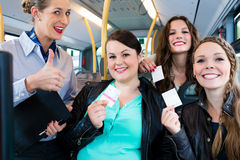 Bus passengers having bought a ticket Royalty Free Stock Photos