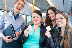 Bus passengers having bought a ticket Stock Images