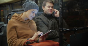 Bus passengers using cellphone and pad stock footage