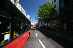 Bus passing by. A red bus in Oxford street passing by with motion blur Stock Photo