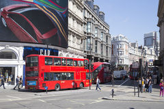 Bus passing large screen in piccadilly circus Stock Photo