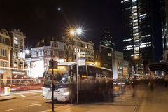 Bus and people at night. In London Stock Photo