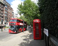Bus and phone booth. A bus and a phone booth on the street, outside Kensington/Hyde Park Royalty Free Stock Photography