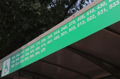 Bus public transport New Delhi India. Bus stop displays bus number information in New Delhi India Royalty Free Stock Photography