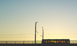 Bus rides on the bridge. Sunset. In the City Stock Photos