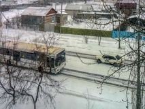 The bus rides in snowy weather on a snowy road stock images