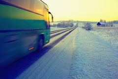 Bus rides on winter road in the snow Royalty Free Stock Images