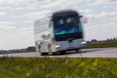 Bus on the road with motion blur. Blurred image background. Colo Royalty Free Stock Photography