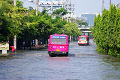 BUS ON THE ROAD WITH WATER FLOOD Royalty Free Stock Photography