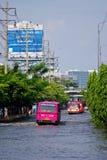 BUS ON THE ROAD WITH WATER FLOOD. BANGKOK, THAILAND - NOV 7 : BUS ON THE ROAD WITH WATER FLOOD  ON NOV 7, 2011 IN KAMPHAENG PHET INTERSECTION, BANGKOK, THAILAND Stock Photography