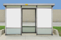 Bus shelter. Bus stop, against a brick wall royalty free stock image